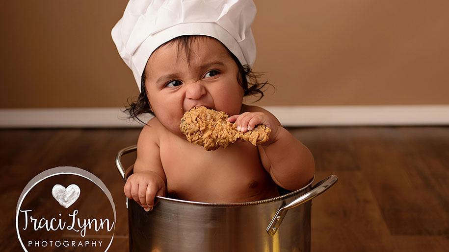 baby eating fried chicken