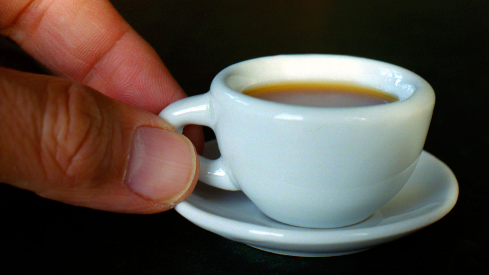 A miniature cup of coffee.