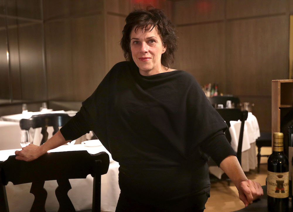 Chef Barbara Lynch poses for a portrait in the dining room of her restaurant Menton in Boston