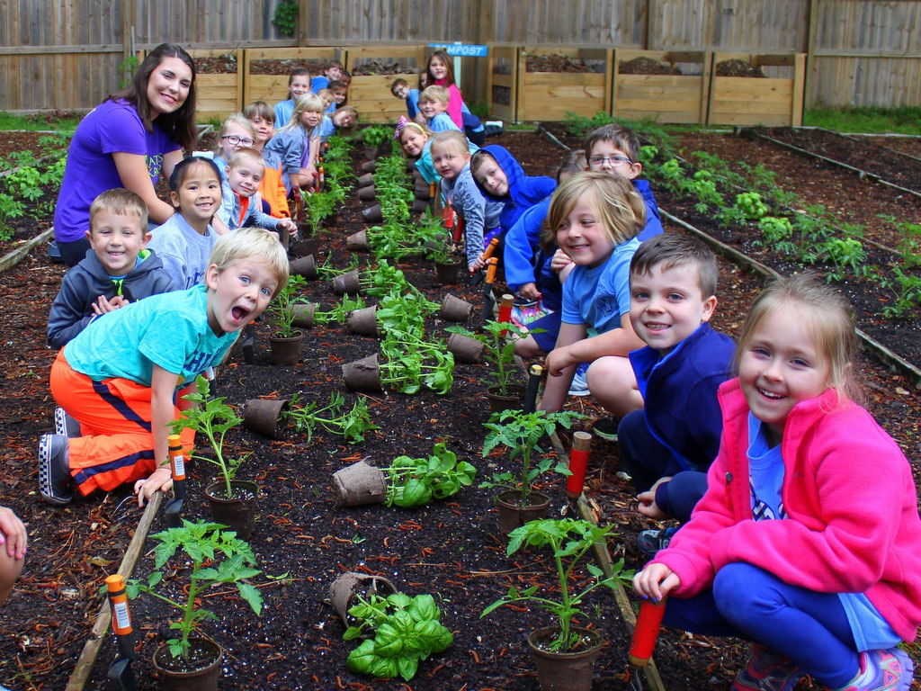 Katie gardening with kids at her school garden