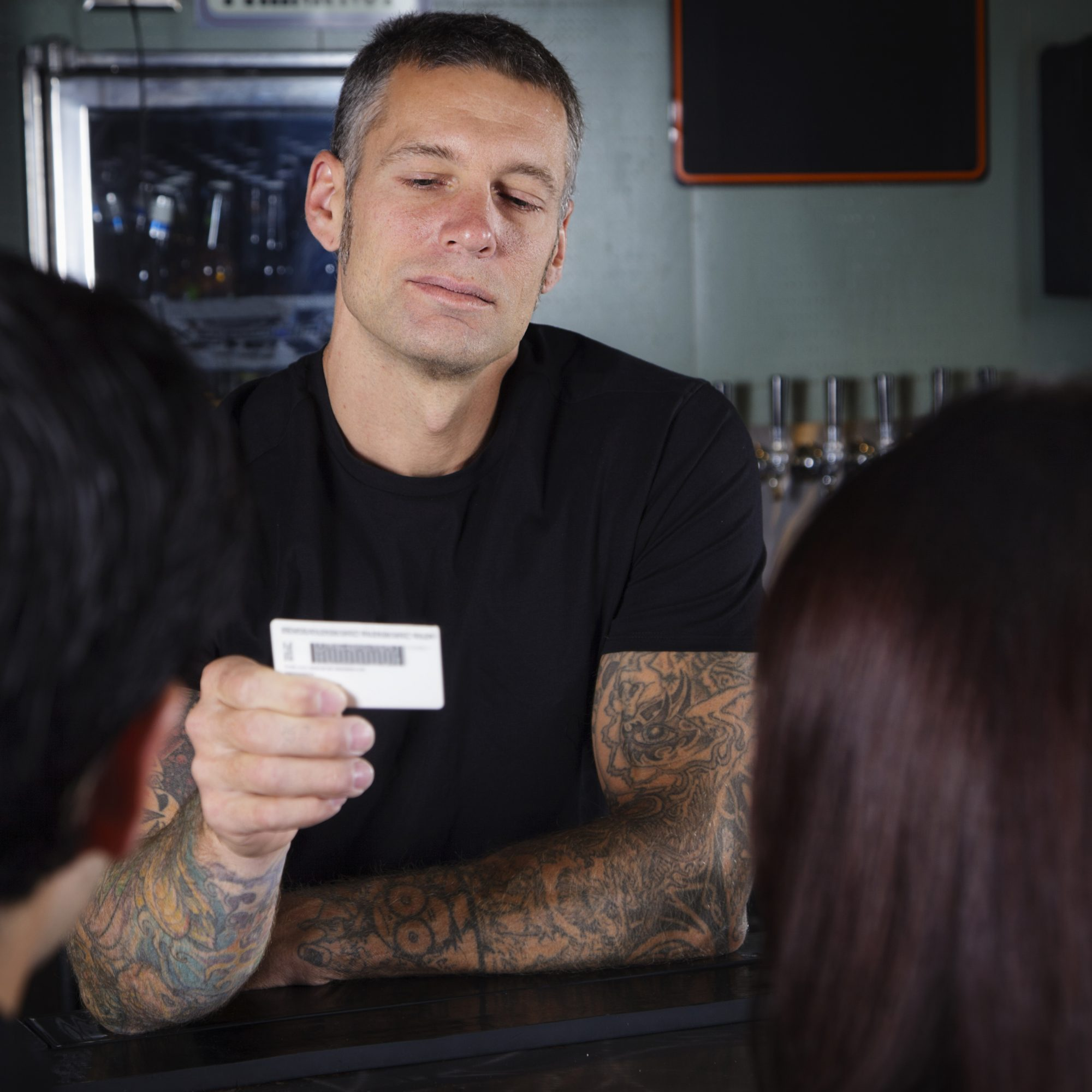 bartender-checking-id-fwx