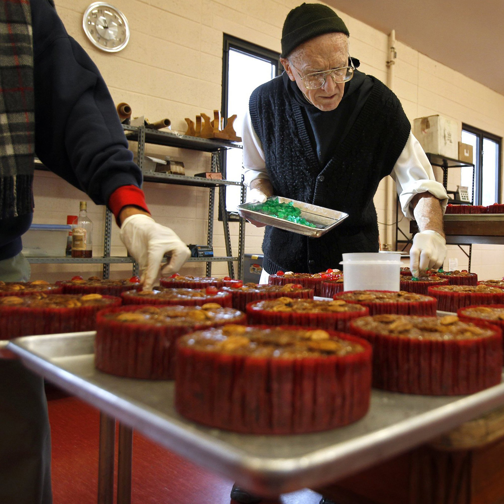 A monk prepares fruitcakes in Missouri.