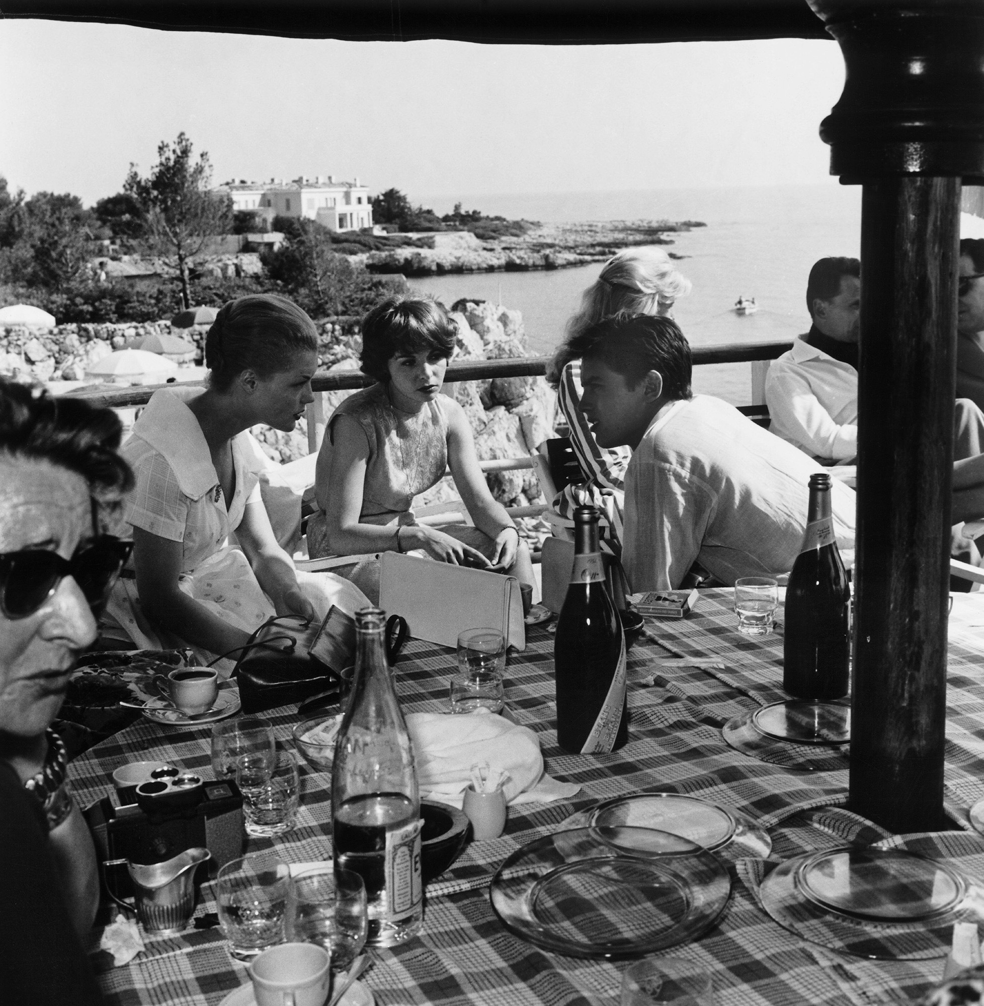 FRANCE - MAY 11:  At Eden Rock in the Cape of Antibes, Romy SCHNEIDER, Francoise ARNOUL and Alain DELON (from left to right) , who came for Cannes Film Festival, lunch on the terrace of a restaurant.  (Photo by Keystone-France/Gamma-Keystone via Getty Ima
