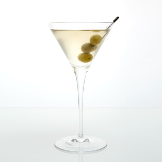 A true dry martini tastes best when served with a twist, rather than an olive. This is largely a matter of taste, and there are many schools either way, but a bit of lemon rind, twisted over the top of the martini imparts a gently spray of lemon oils to the surface.