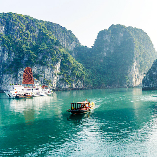Take a cruise in Hạ Long Bay, Vietnam.