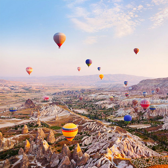 Float on a hot-air balloon in Cappadocia, Turkey.