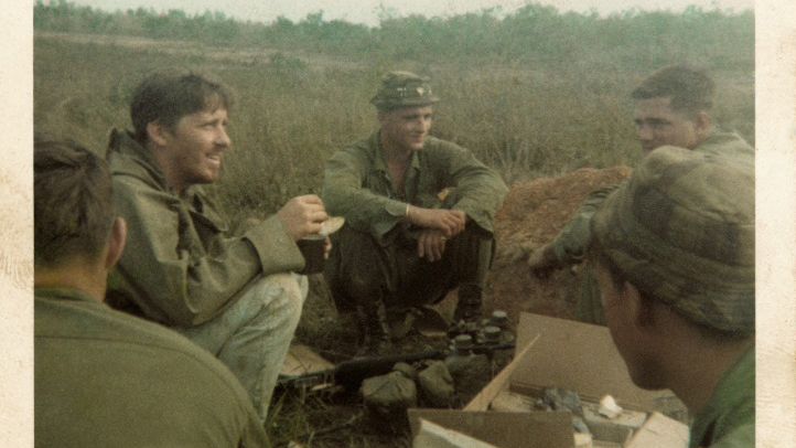 Chick (second from left) with the four GIs in Vietnam.