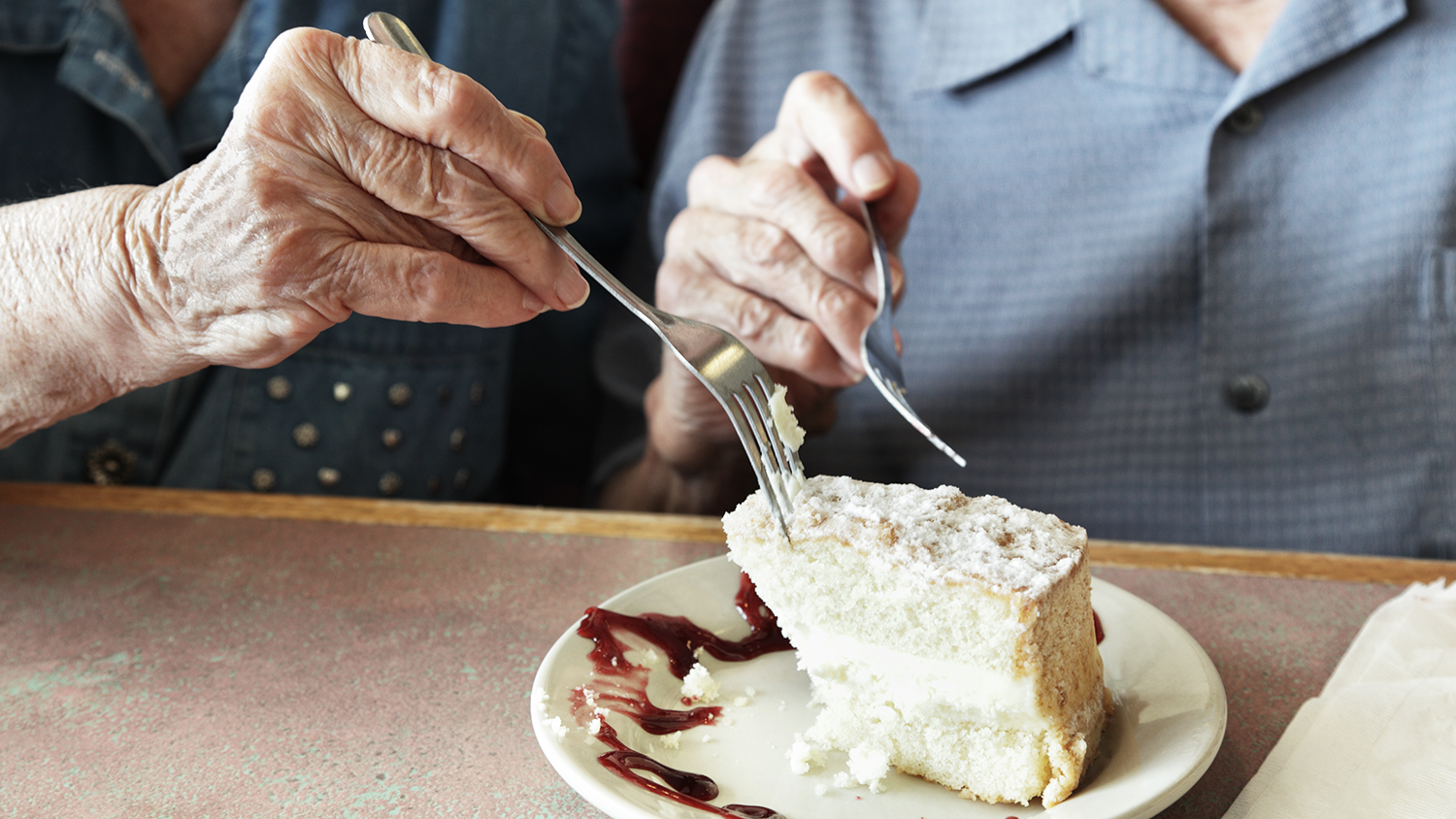 older couple eating cake