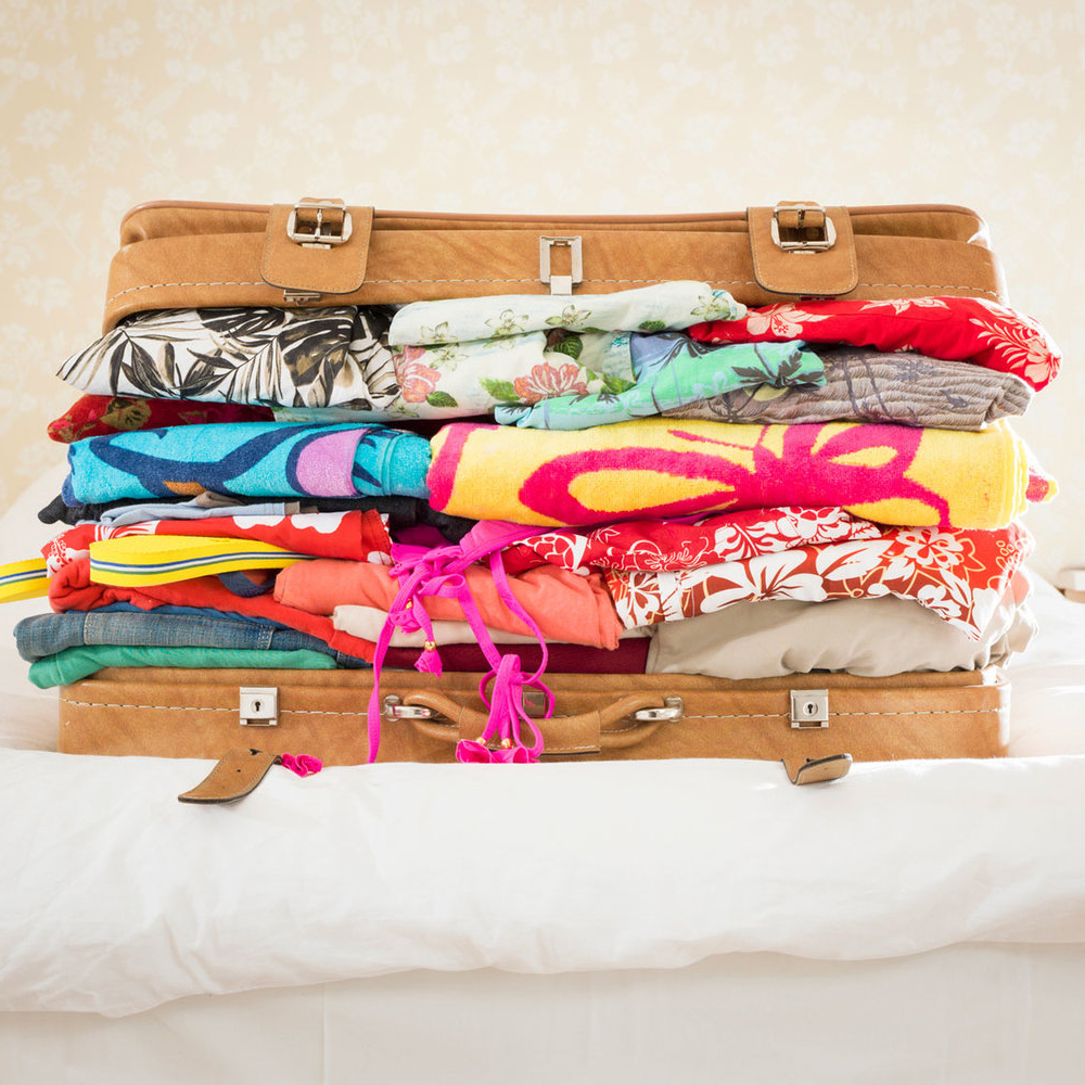 suitcase-clothes-TL-partner-fwx