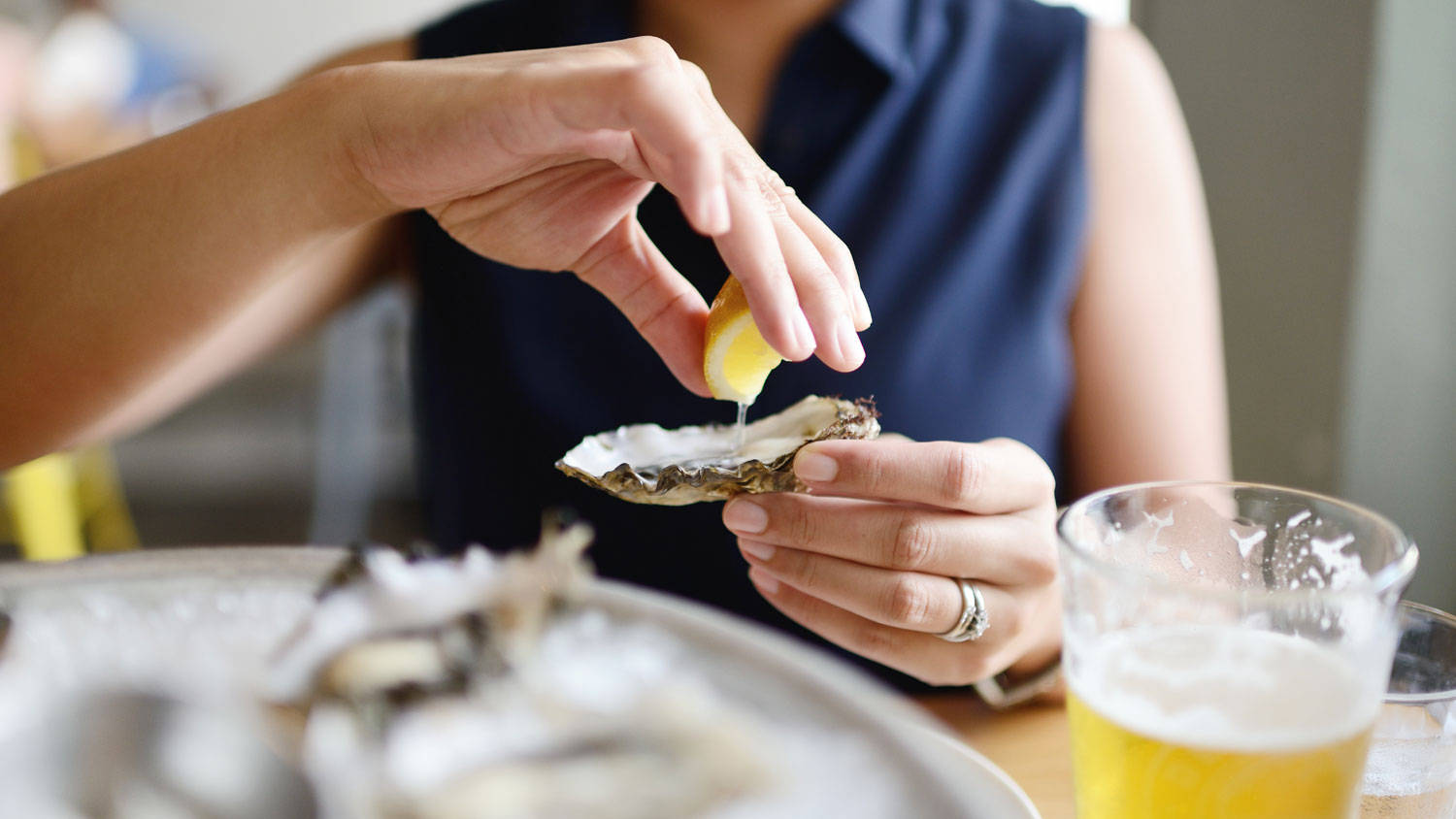 Watch 100 People Try Their First Raw Oyster