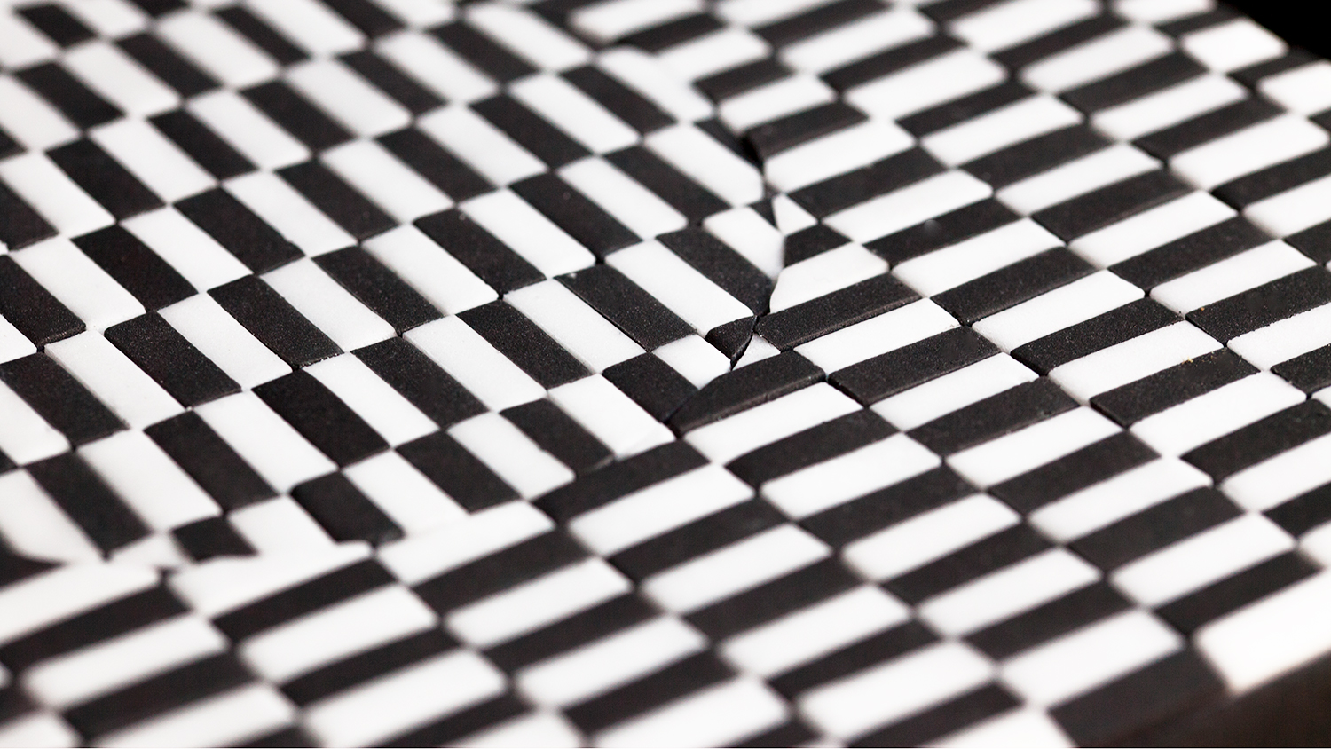 black and white optical illusion cake close up