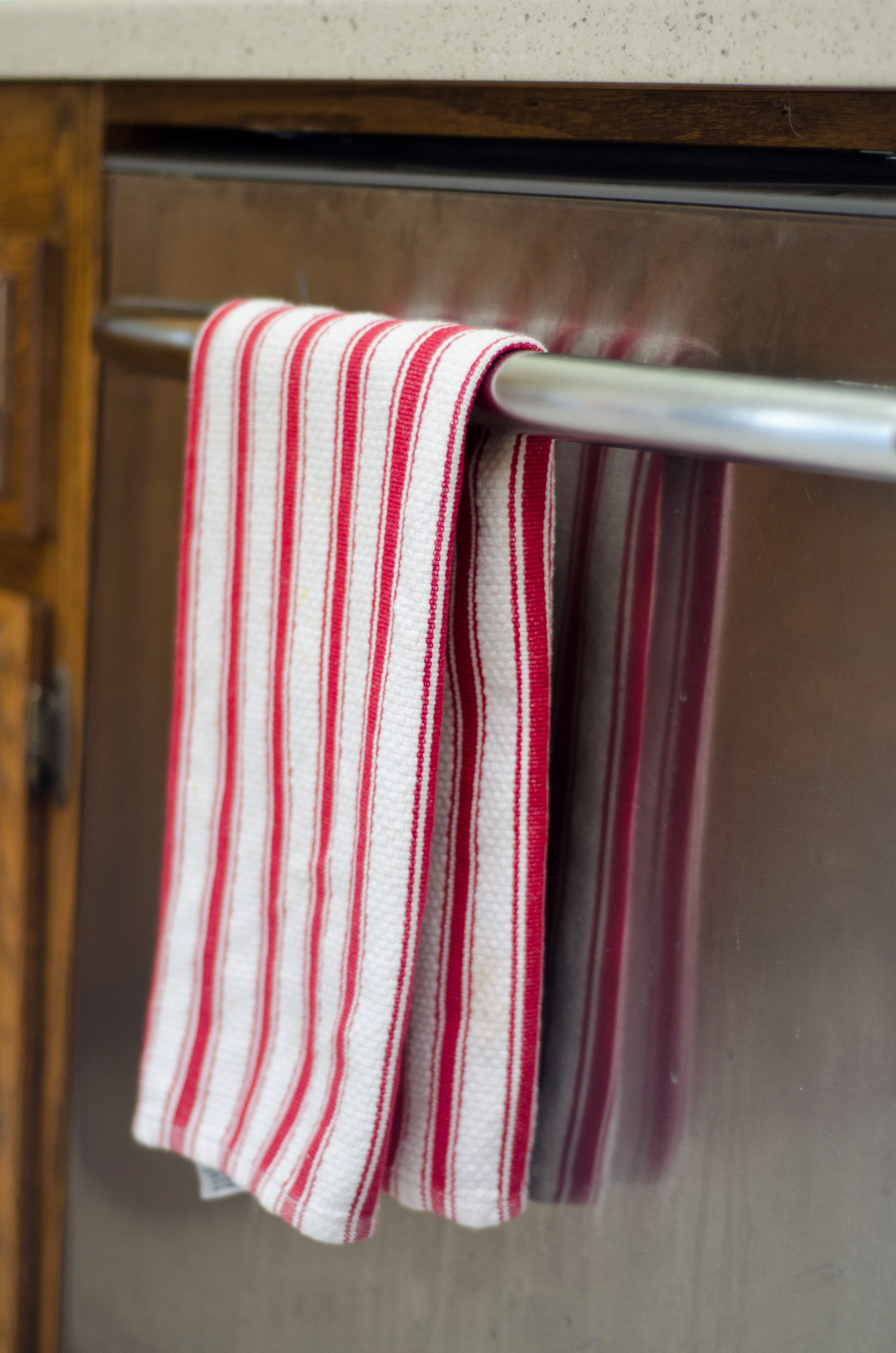 Here's Why You Might Want to Hang a Dish Towel on Your Dishwasher