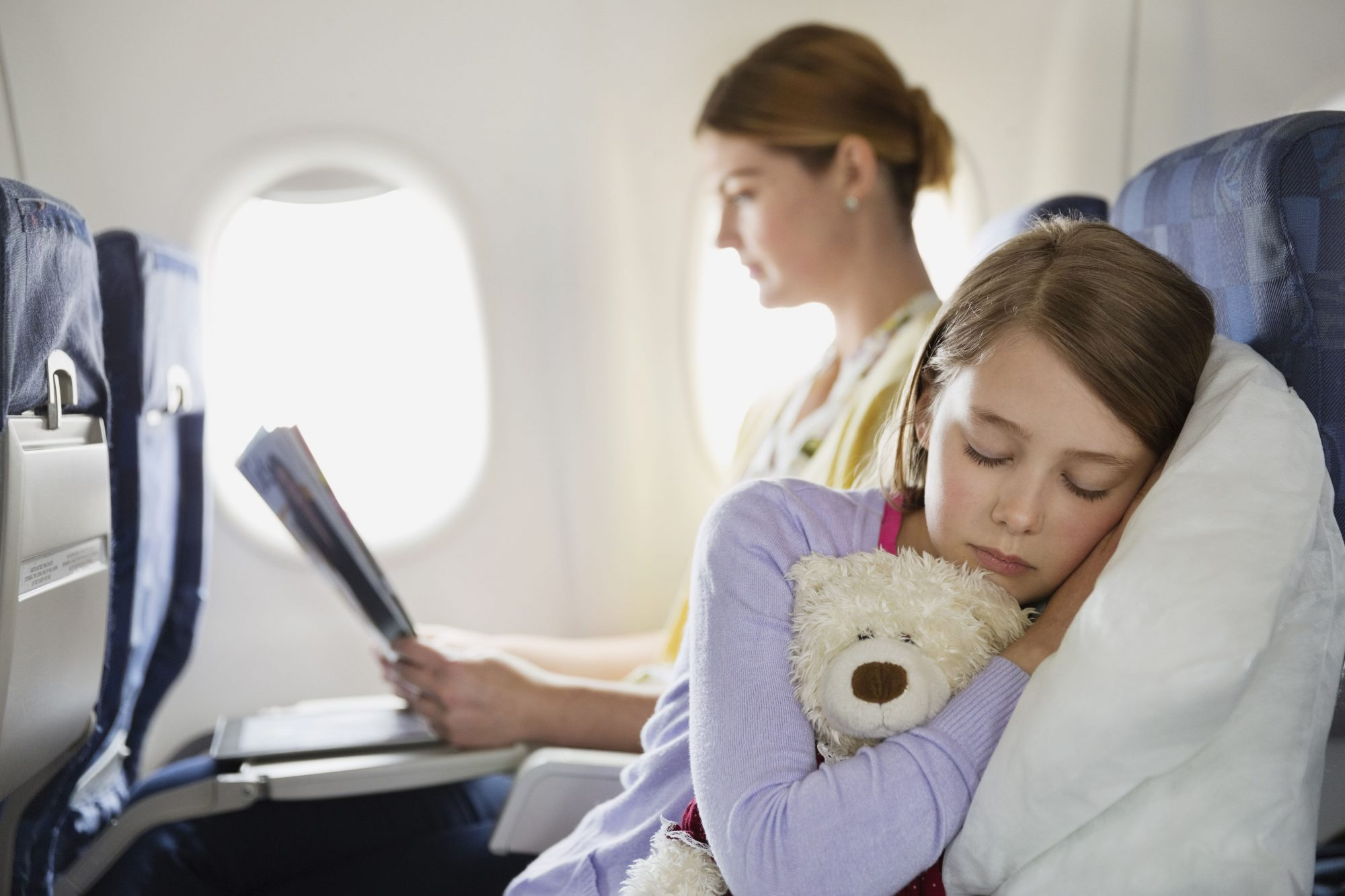 Mother and Daughter on Airplane