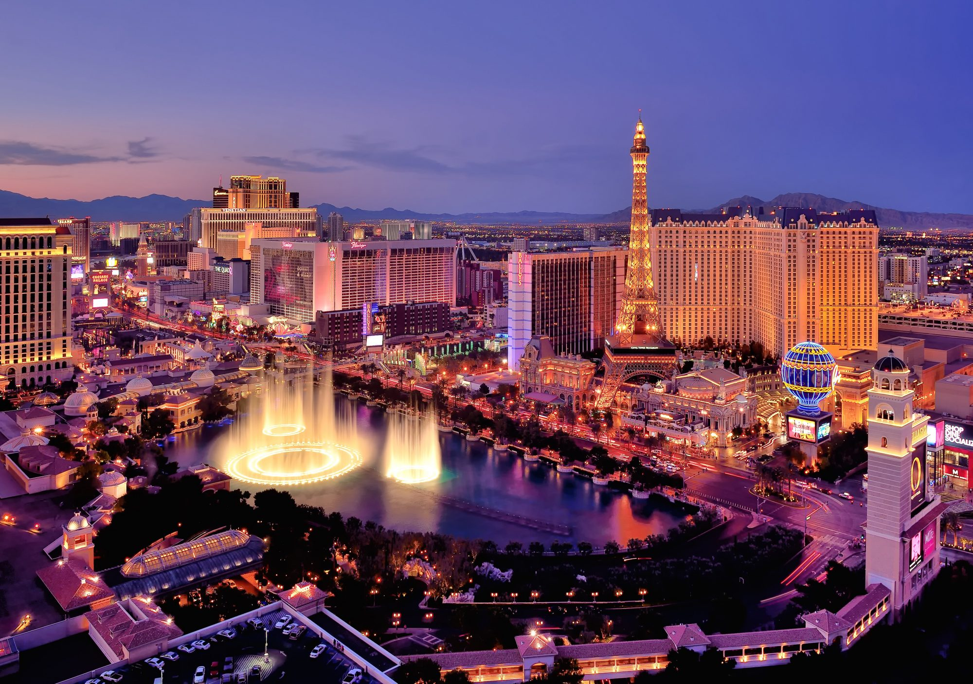 City skyline at night with Bellagio Hotel water fountains, Las Vegas.