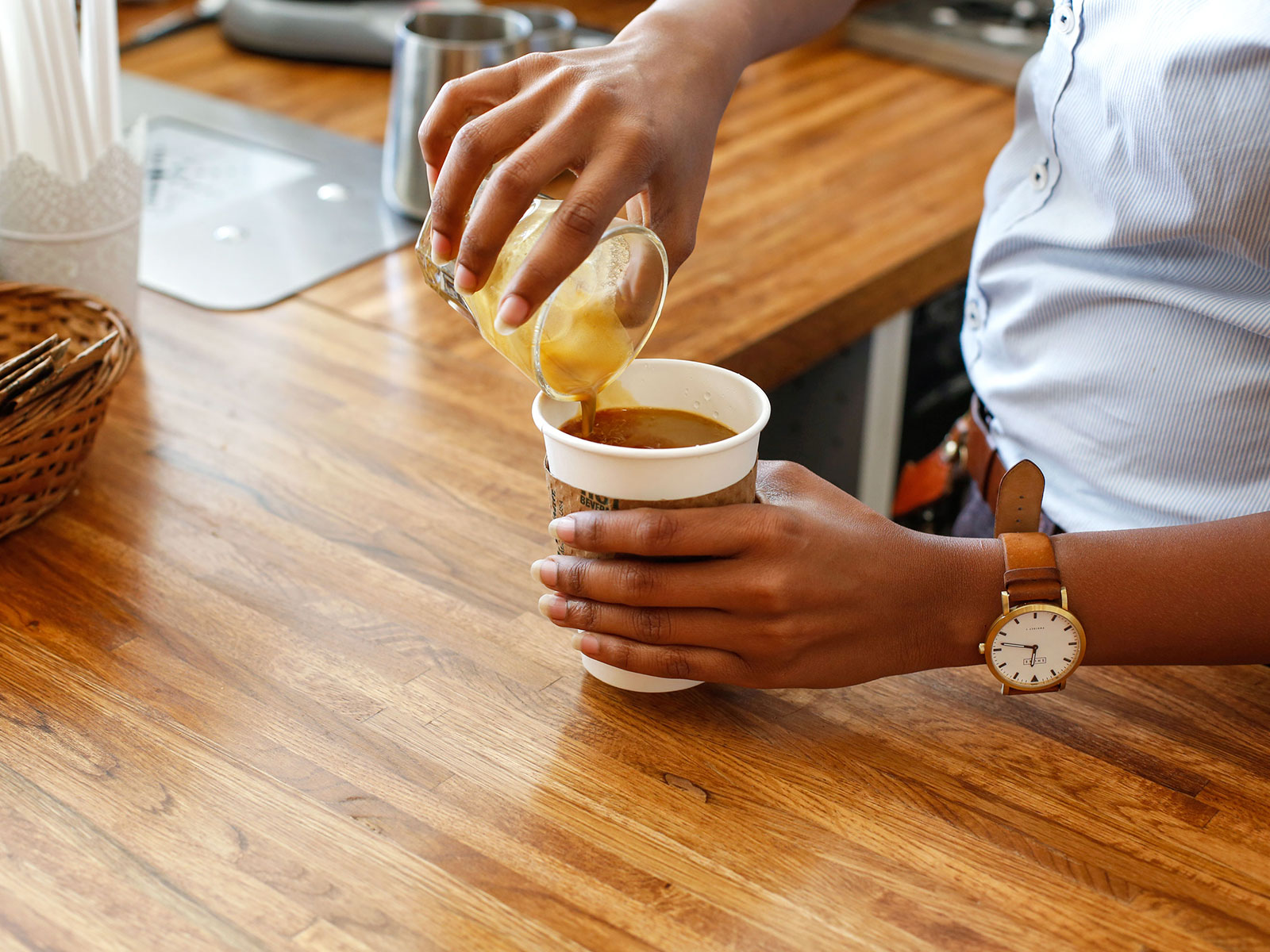 pouring espresso into a to go cup in newark new jersey