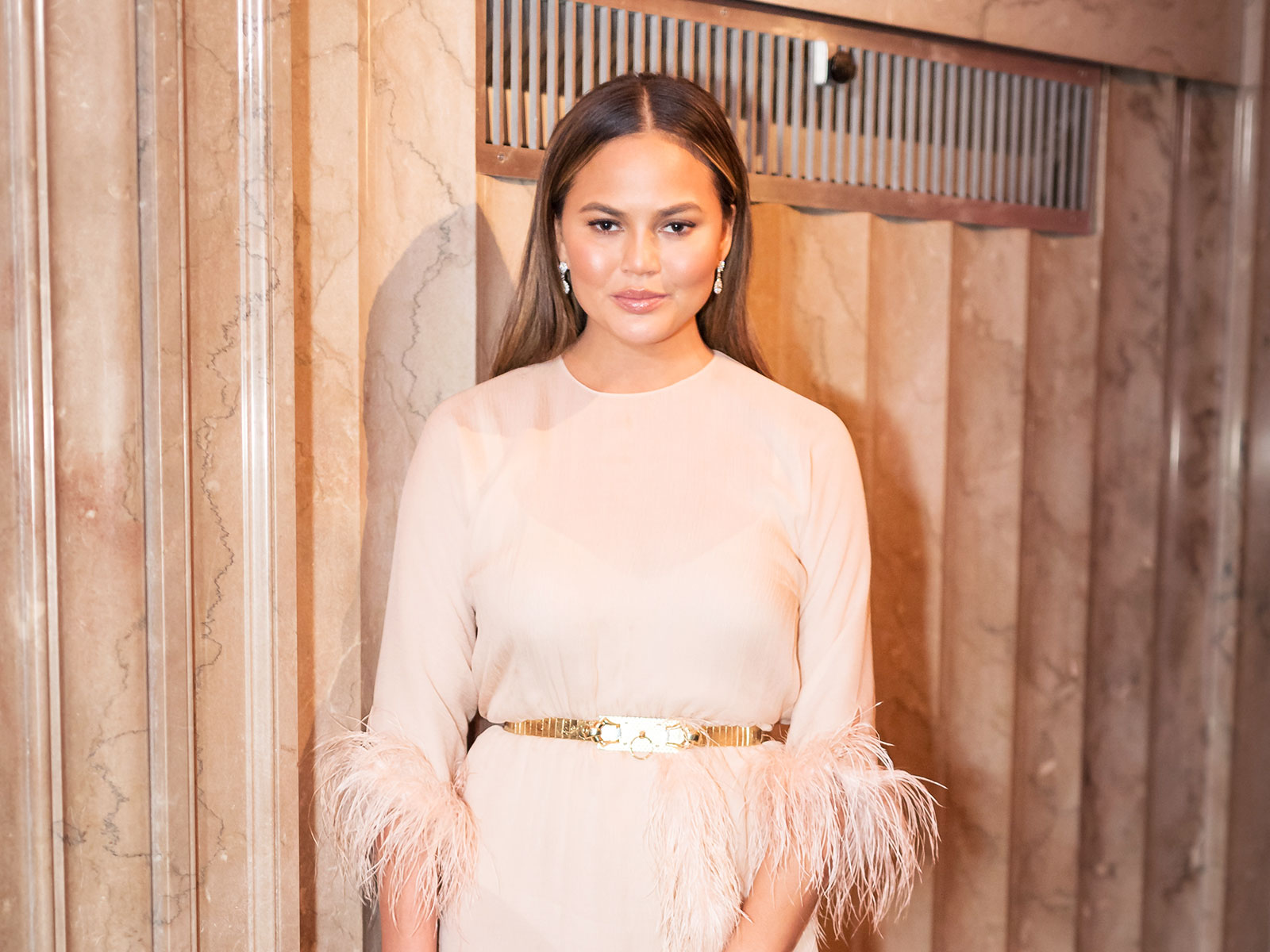 chrissy tegan avocado suit