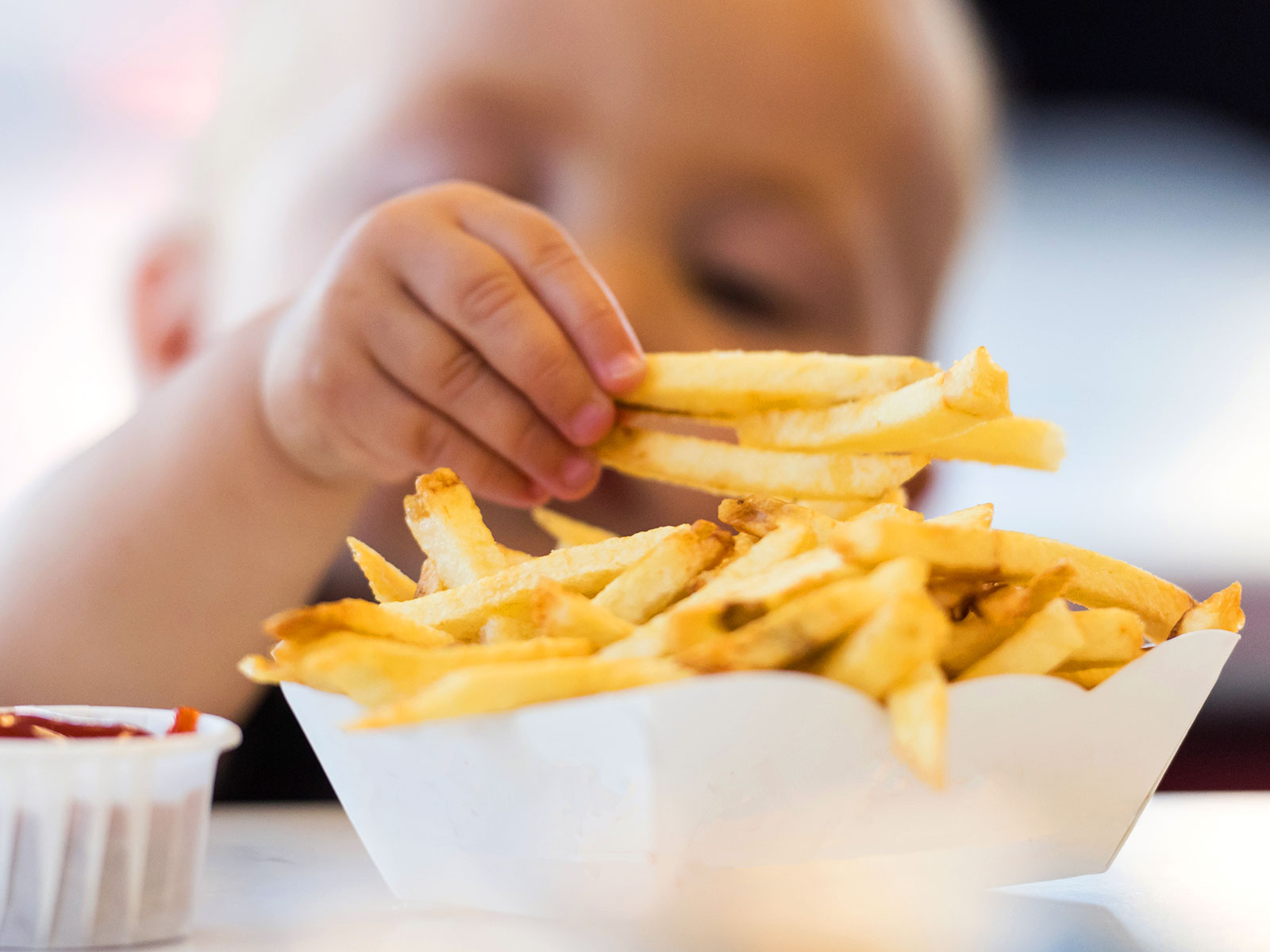 baby takes first steps for french fries