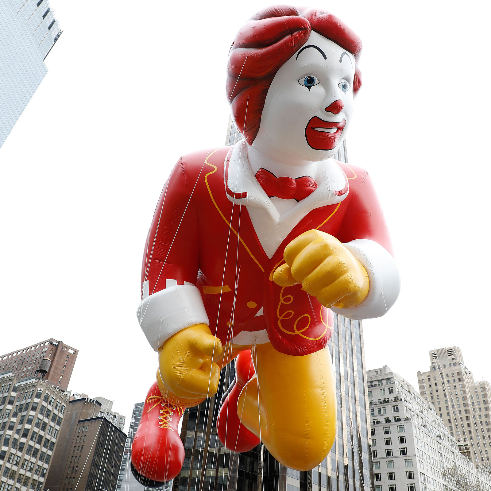 ronald mcdonald in the marching band float thanksgiving day parade
