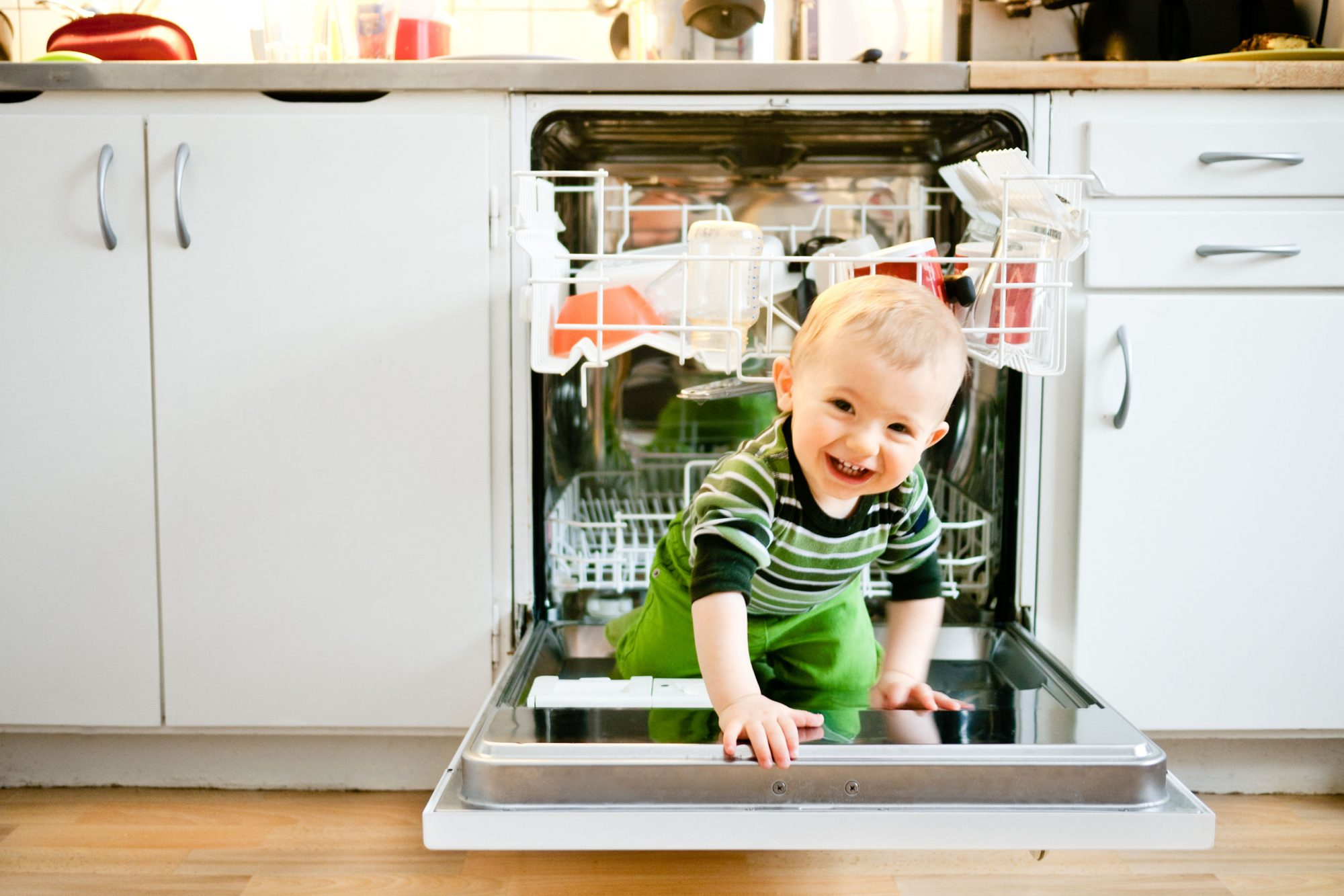 baby crawling out of dishwasher
