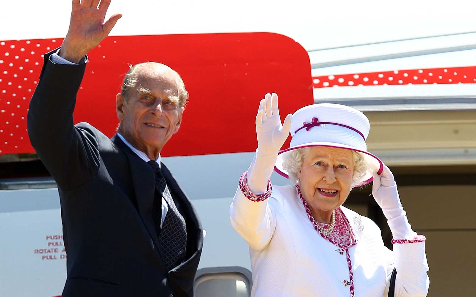 Britain's Queen Elizabeth II and Prince Philip wave farewell to Australia at Perth International Airport