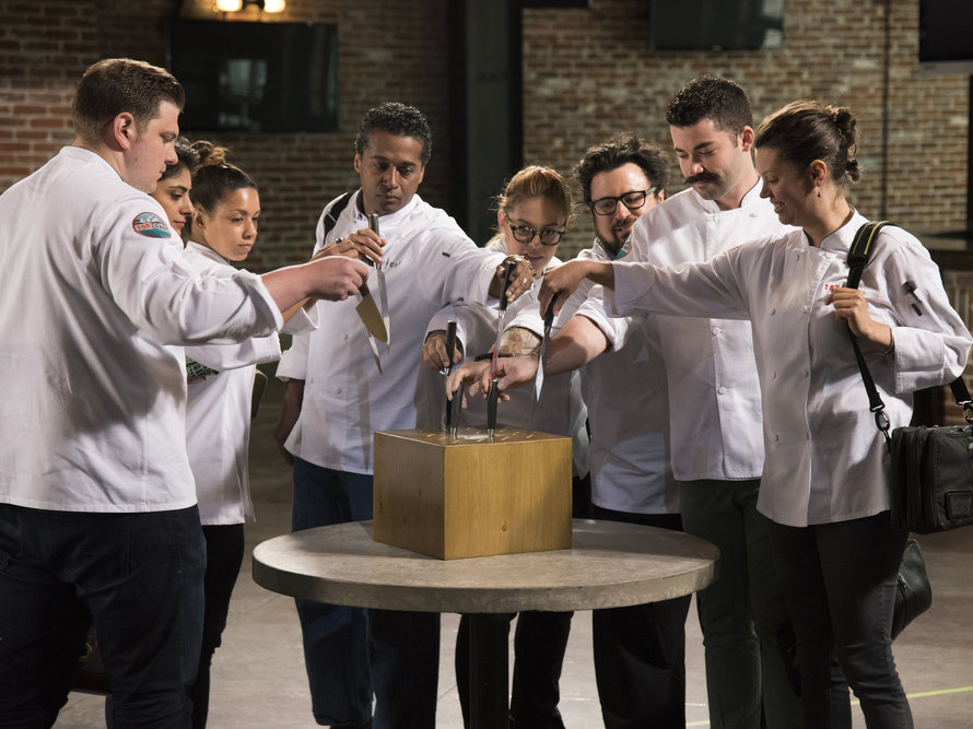 The chefs draw knives and divide into teams for Restaurant Wars.