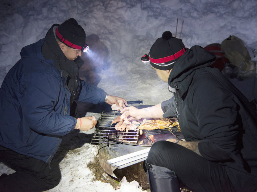 Brother and Tu grill into the cold Colorado night.