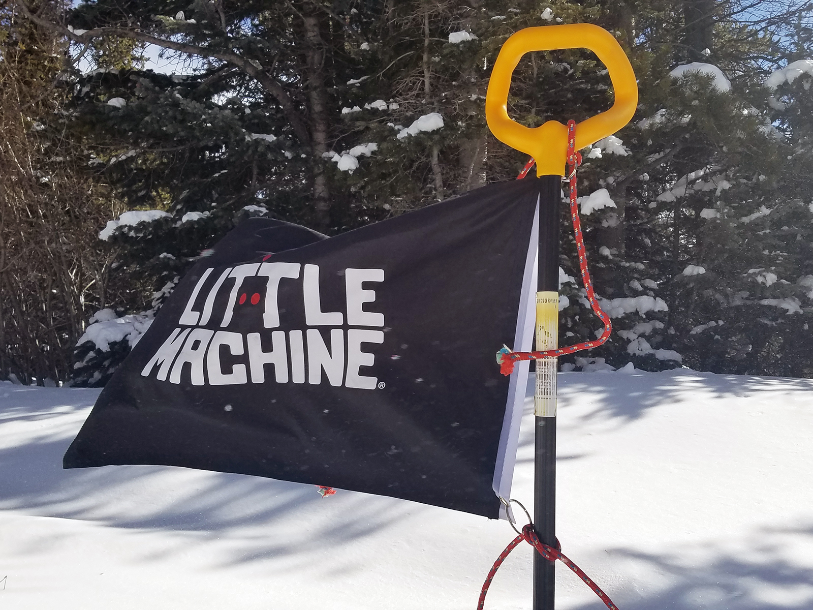 little machine flag on shovel and snow