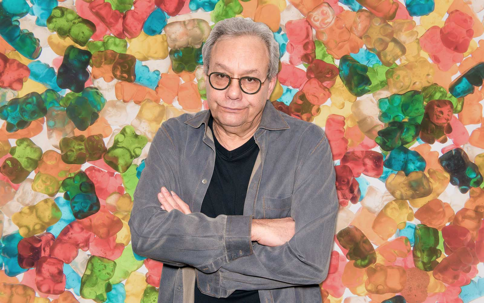 Comedian Lewis Black with gummy bears in background