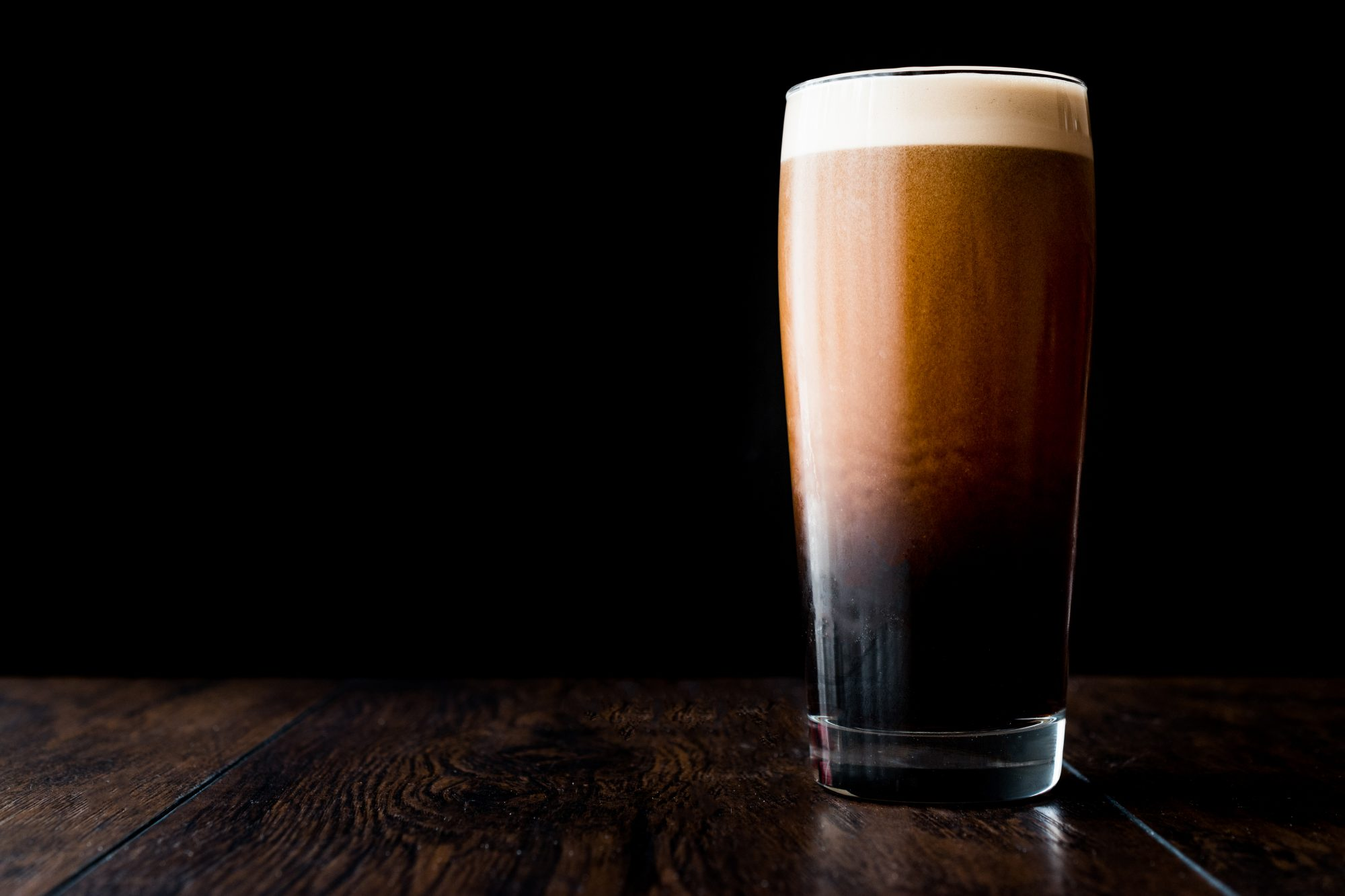 Why Do Some Beer Bubbles Appear to Defy Physics?