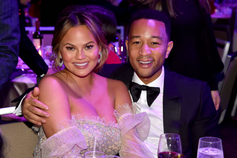John Legend Says He's Been Cooking for Pregnant Chrissy Teigen Because She 'Needs to Sit Down More'