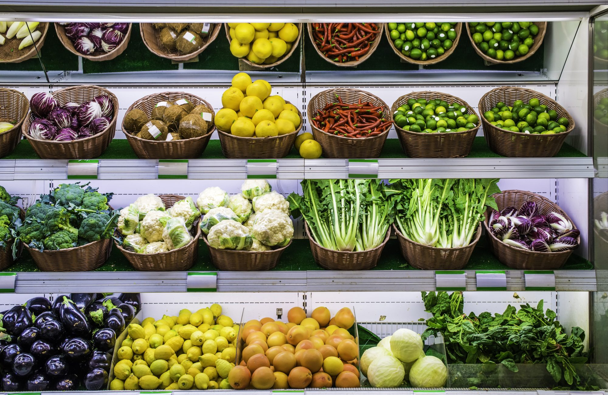 Fruits and vegetables on a supermarket shelf.