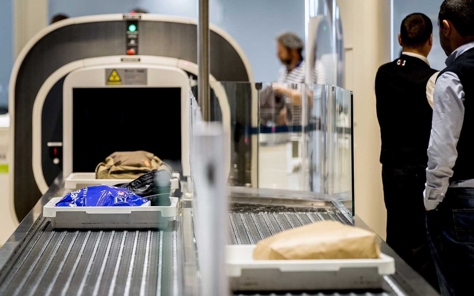 Bags are scanned with the new hand baggage scan at Schiphol Airport, in Amsterdam