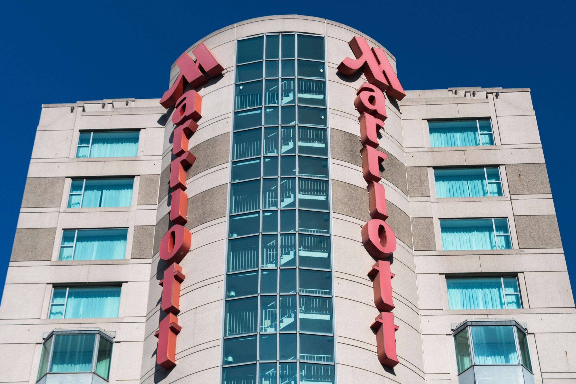 Marriott hotel sign in a downtown building, red metal