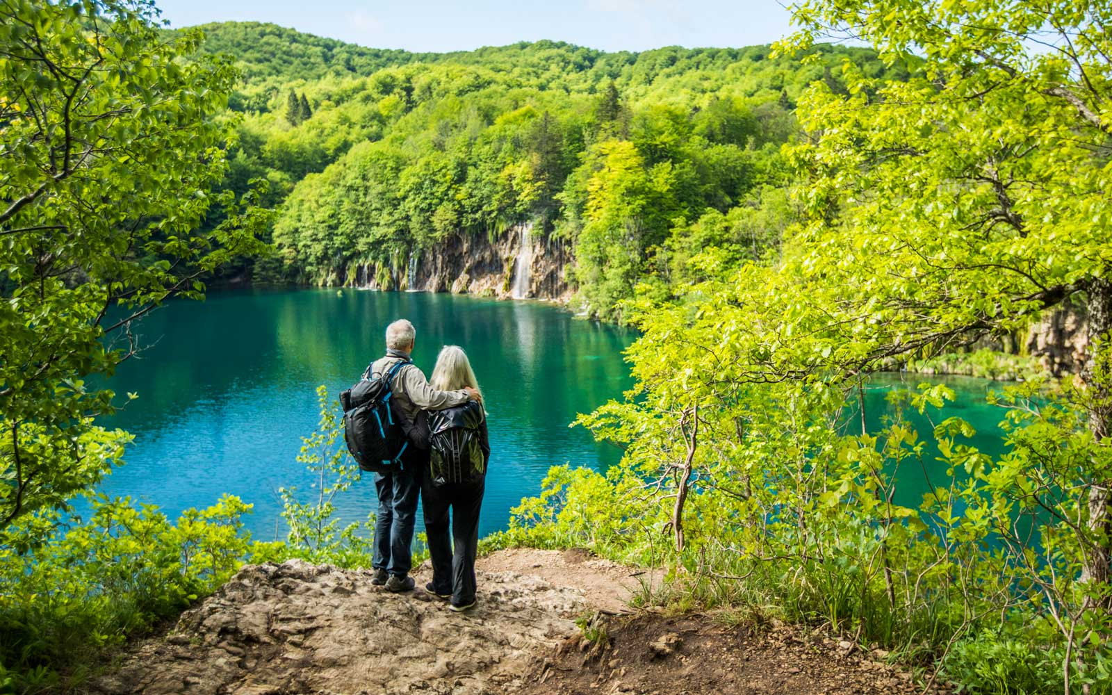 Retired couple traveling on a hike