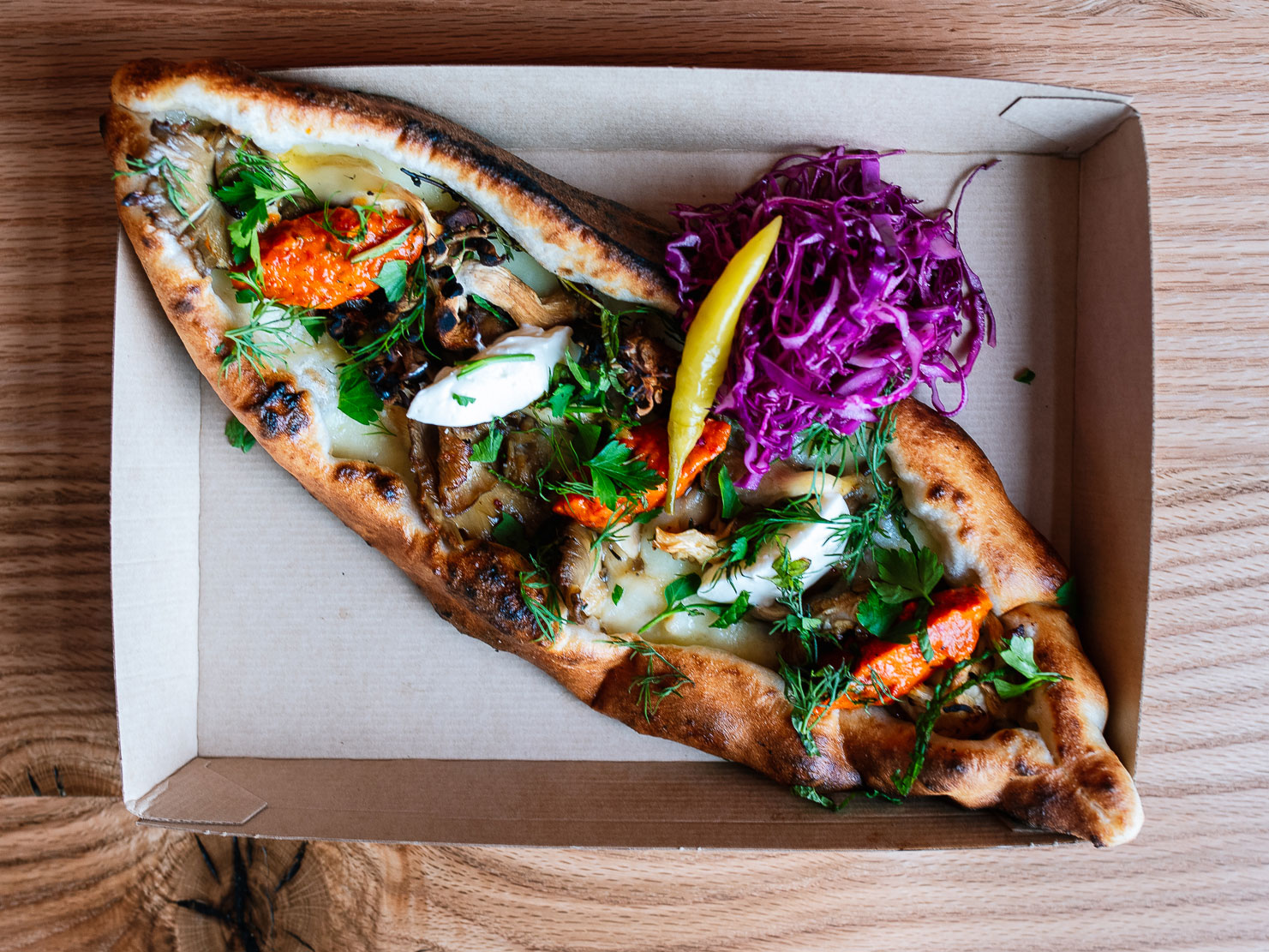 Wood-fired pide flatbread at Balkan Treat Box