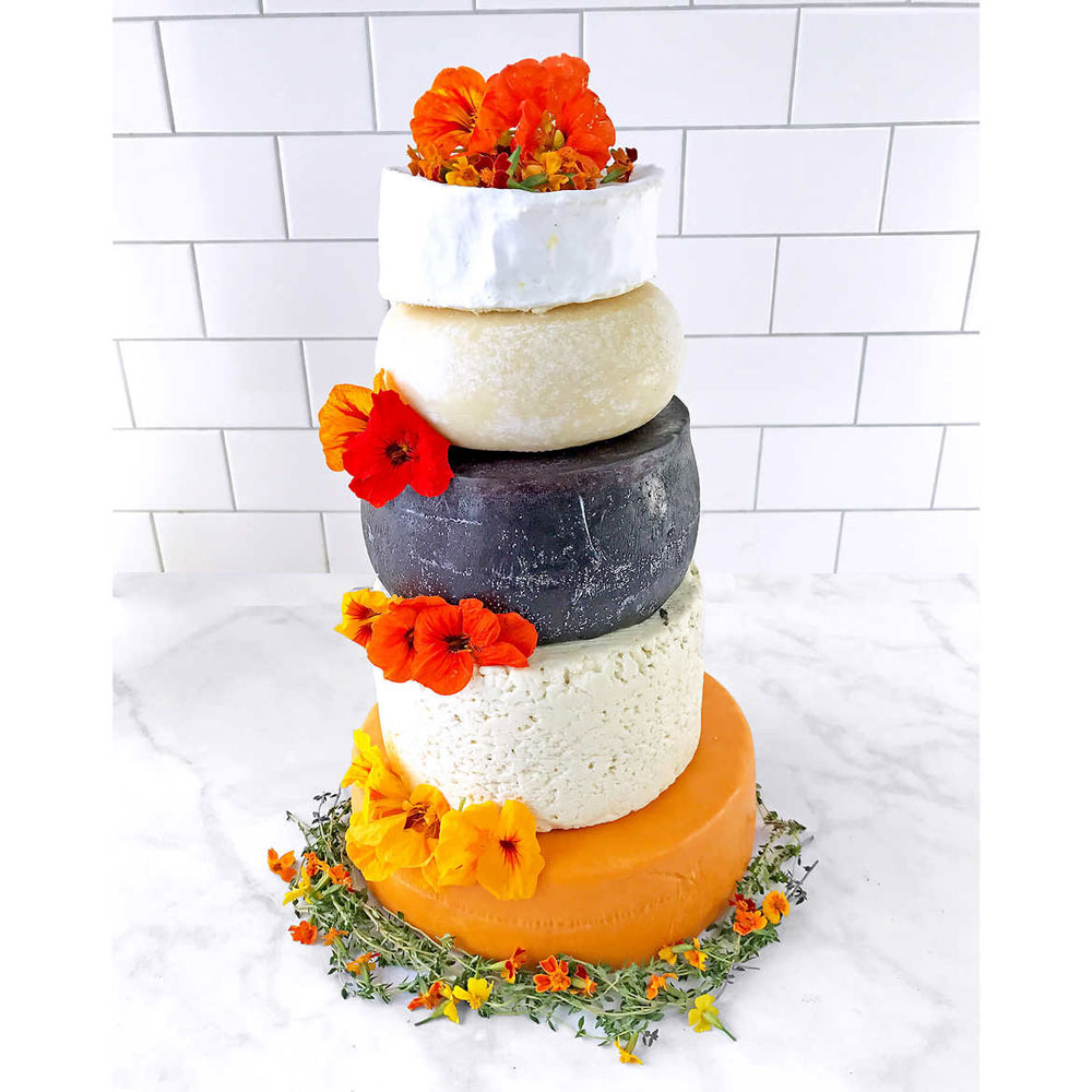 Savory Wedding Cakes You Need to See: Tiered Cheese Wheels, Meat Pies, and More