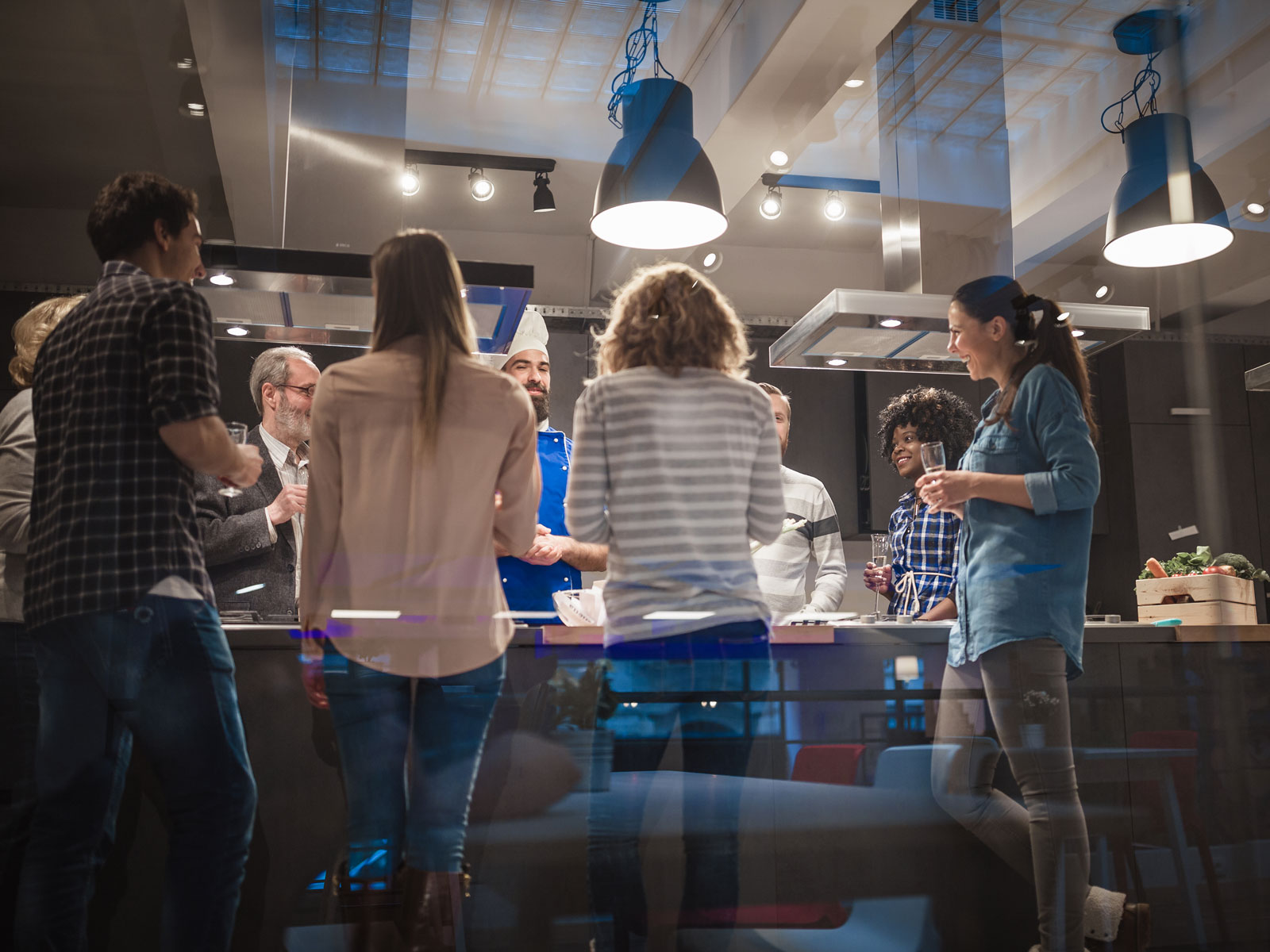 People standing in a professional kitchen celebrating