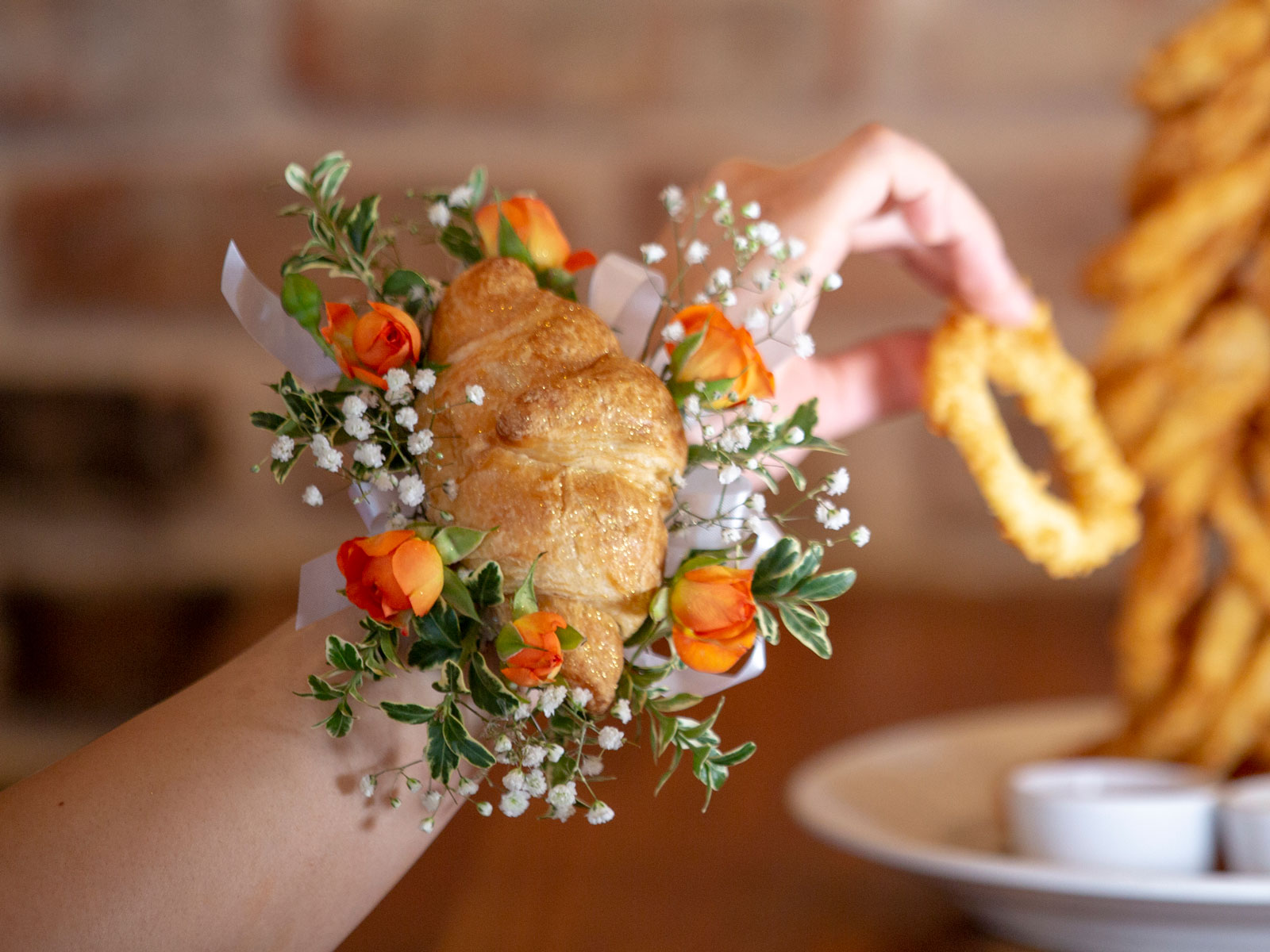 These 'Croissant Corsages' Turn an Autocorrect Joke Into an Edible Prom Necessity