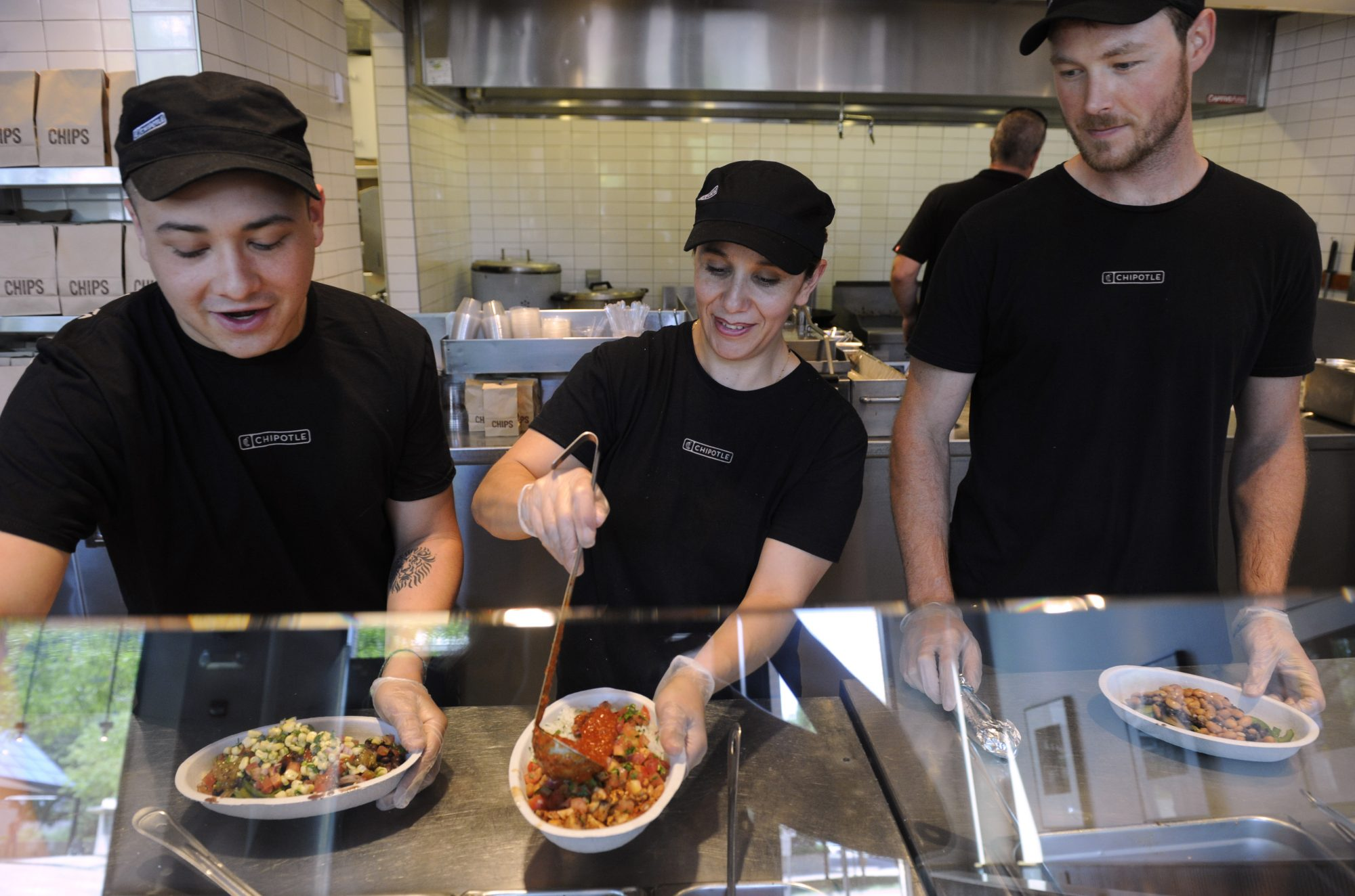 Employees at the Chipotle restaurant in LoDo at 1480 16th ST. in Denver perform all the prep work needed to get ready for the lunch crowd on Friday, June 29, 2012. Getting ready for the shift meeting are from left to right, Josh Pisani, Angelica...