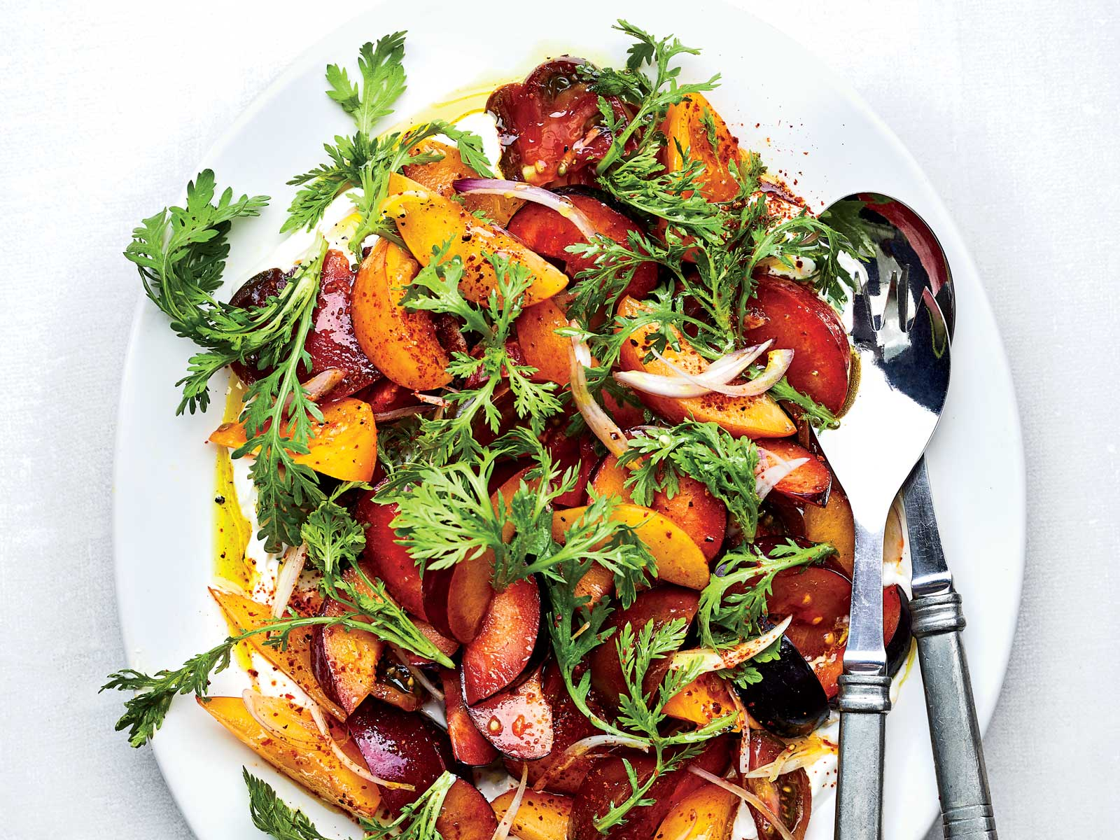 Tomato and Plum Salad with Chrysanthemum Greens and Madras Curry Vinaigrette