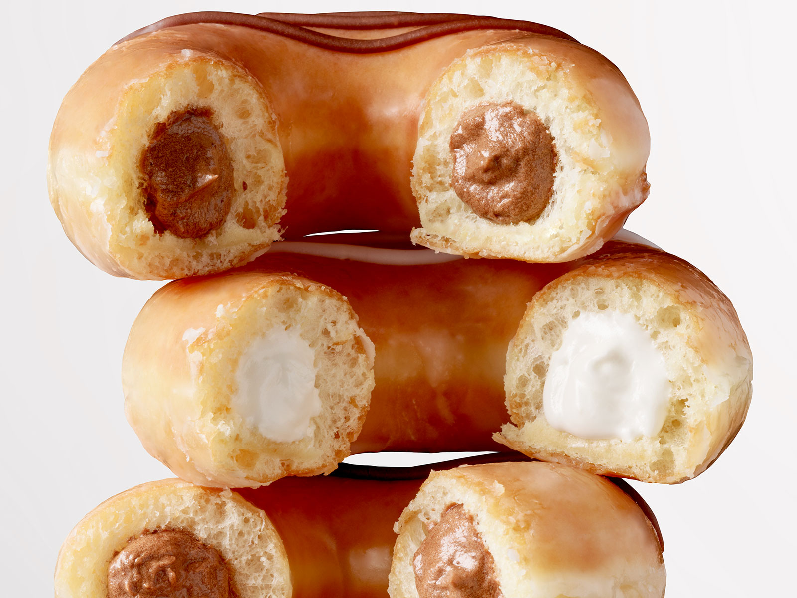 Krispy Kreme Adds Filled Original Glazed Doughnuts to the Menu—Permanently