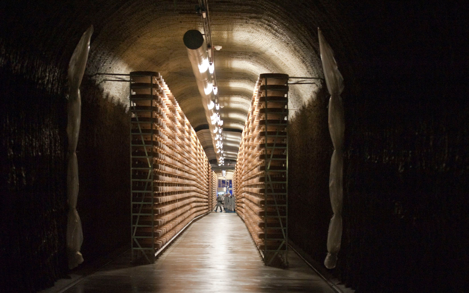 This Cave in a Swiss Mountain Is Used to Age 156,000 Wheels of Cheese