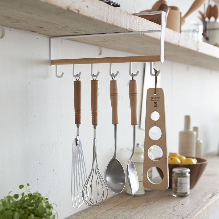 White and wood hanging kitchen tools storage rack