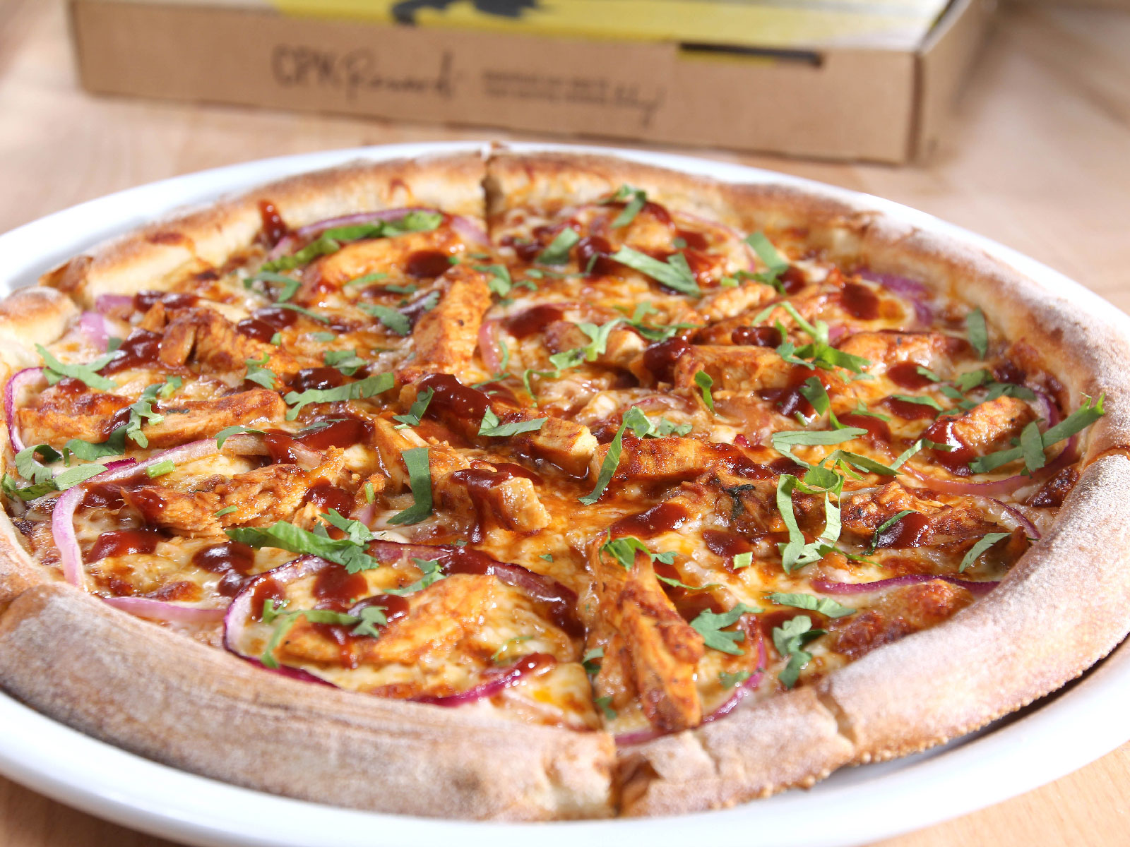 California Pizza Kitchen Adds Take-and-Bake Option Nationwide
