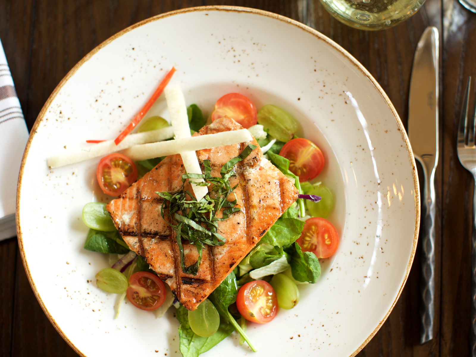 Virtuous food options, like grilled Alaskan king salmon with tomato, grape, and basil, are par for the course on Holland America's cruises